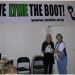 October 2010-  Pictured left to right under the Give Lyme the Boot banner are- Kristi Broadway, Director of the Community Recreation & Resource Center, and Harriet Bishop, President of Texas Lyme Disease Association.  Harriet, a mother of 5, grandmother of 15 and great-grandmother of 5 additional children, continues to be very active in Lyme disease advocacy.