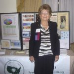 Pat Smith, President, Lyme Disease Association, in front of exhibit table ~  September 29, 2012. LDA/Columbia Annual Scientific Conference ~  (Photo: Jessica Harper Thomson)
