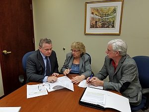 Rep. Chris Smith, Pat Smith, Rich Smith discussing actions to take for House Lyme Caucus
